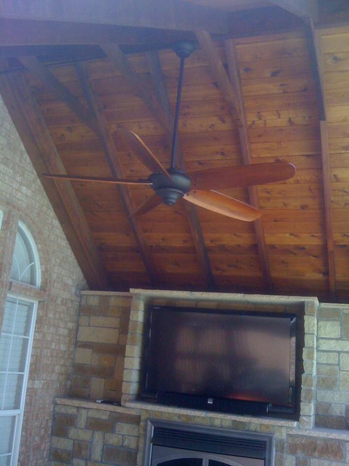 Outdoor entertainment area with a fan